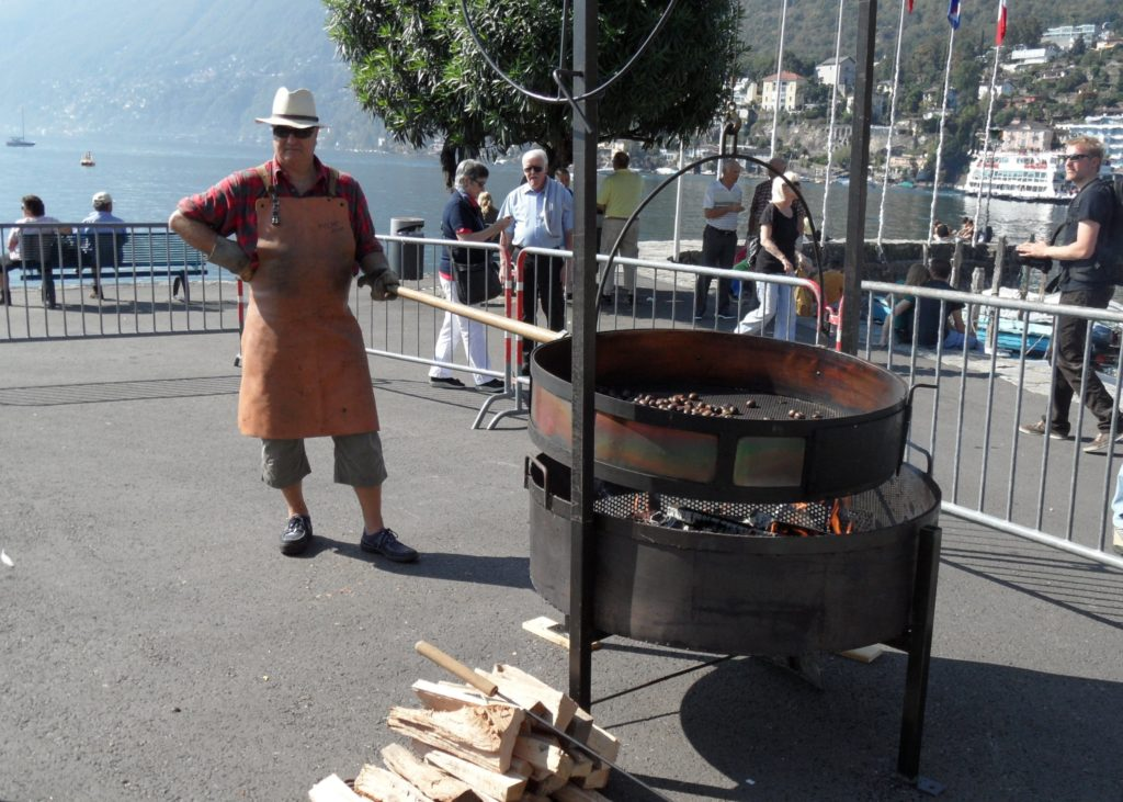 man roasting chestnuts, chestnut festival, Lake Maggiore, switzerland